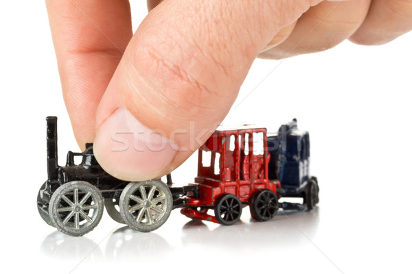 Man playing with metal toy train with locomotive and wagons Stock photo © ShawnHempel