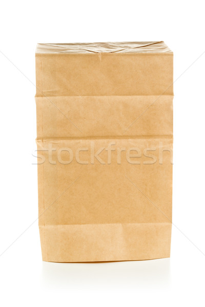 Recycled brown paper bag upside down over white background Stock photo © ShawnHempel