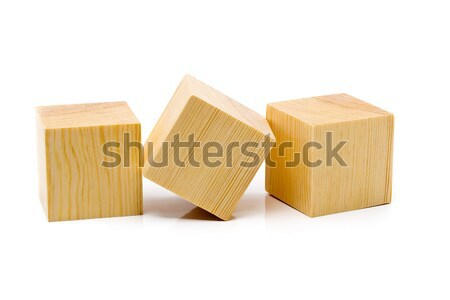 Three brown wooden cubes lined up Stock photo © ShawnHempel