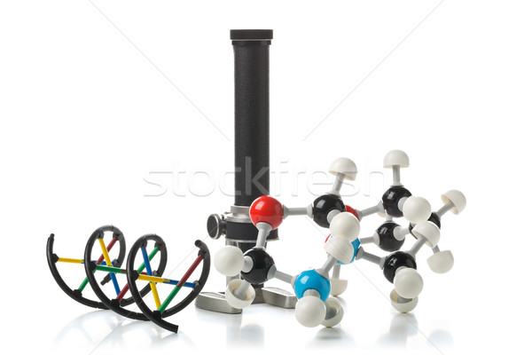 Chemical molecule and DNA structure model with old microscope ov Stock photo © ShawnHempel