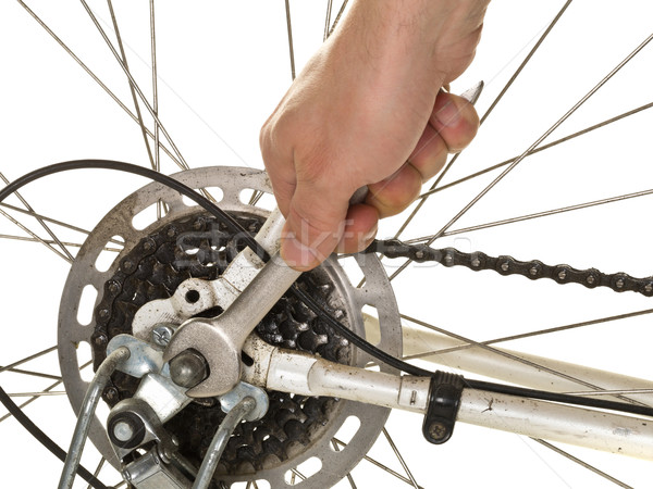 Man repairing rear wheel on a bicycle Stock photo © ShawnHempel