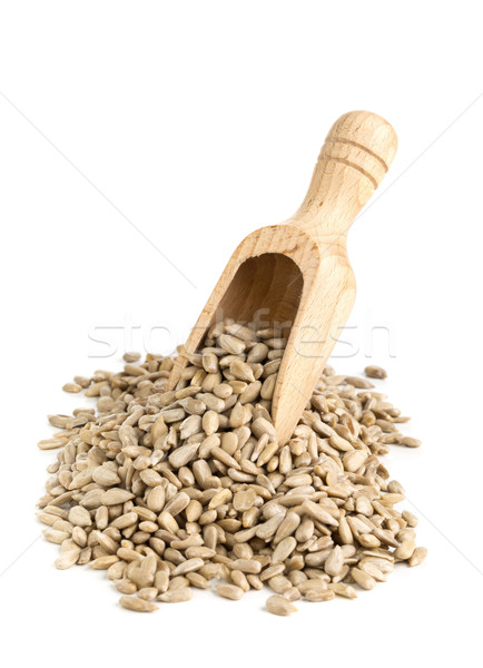 Stock photo: Heap of shelled sunflower seeds in wooden scoop
