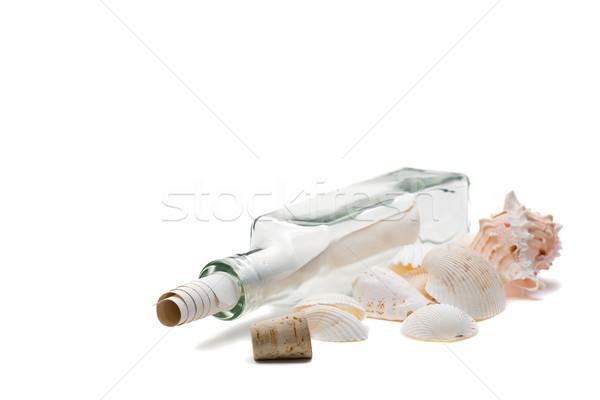 Mesaj şişe beyaz kâğıt cam arka plan Stok fotoğraf © ShawnHempel