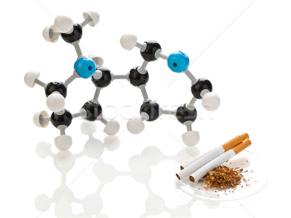 Nicotine molecule with tobacco and cigarettes Stock photo © ShawnHempel