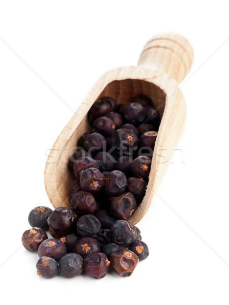 Juniper berries in wooden scoop on white Stock photo © ShawnHempel