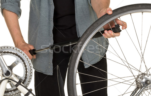 Man refilling front tire on a bicycle Stock photo © ShawnHempel