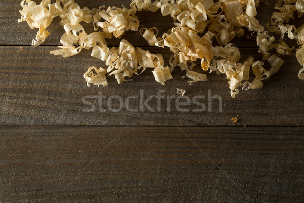 Light brown wood shavings from carpenter's hand planer or chisel Stock photo © ShawnHempel