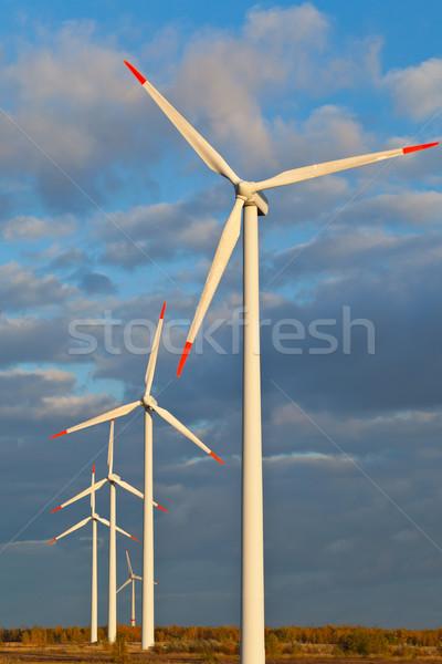 Windmolen macht zonsondergang blauwe hemel natuur technologie Stockfoto © ShawnHempel
