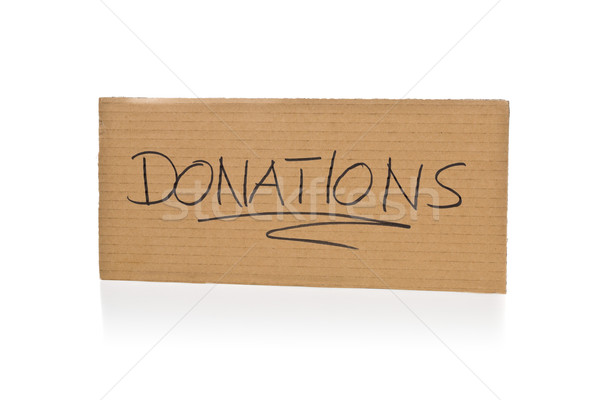 Cardboard sign for donations over white background Stock photo © ShawnHempel
