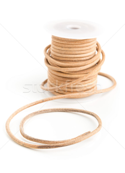 Brun cuir cordon plastique bobine blanche Photo stock © ShawnHempel