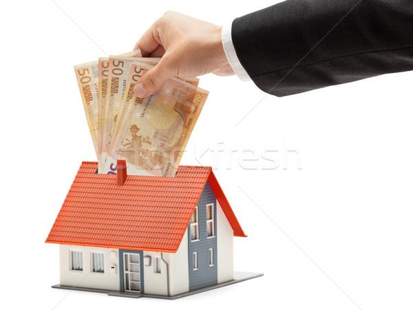 Onroerend investering man euro bankbiljetten model Stockfoto © ShawnHempel