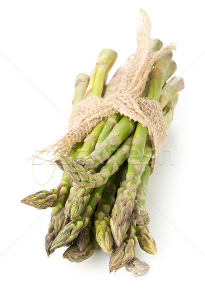 Stock photo: Tied bundle of fresh cut raw, uncooked green asparagus vegetable