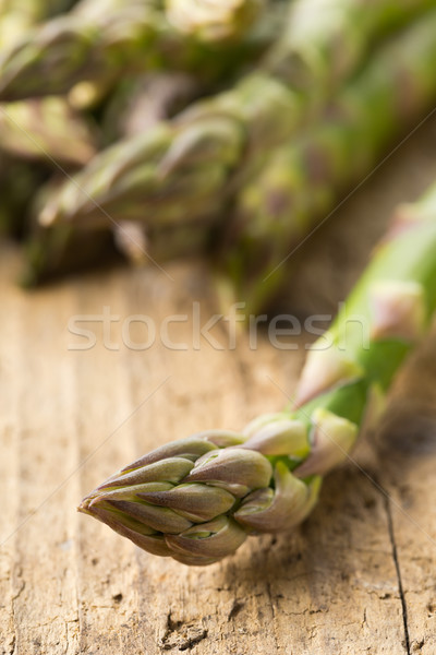 Stock photo: Bundle of fresh cut raw, uncooked green asparagus vegetable