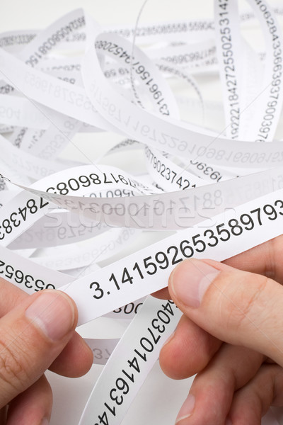 Researcher holding start of printout of the number PI Stock photo © ShawnHempel