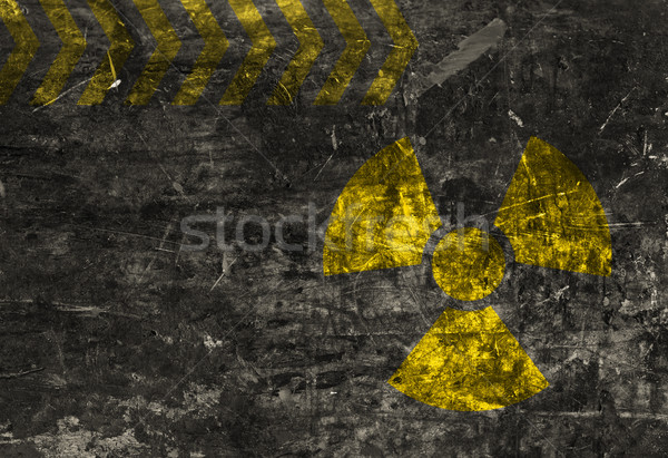 Old grunge distressed black metal plate with radiation warning Stock photo © ShawnHempel