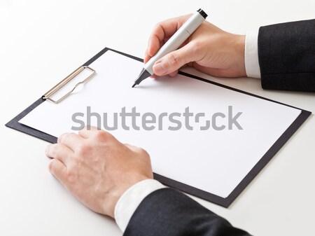 Geschäftsmann Notizen stellt fest Zwischenablage Kopie Raum Büro Stock foto © ShawnHempel