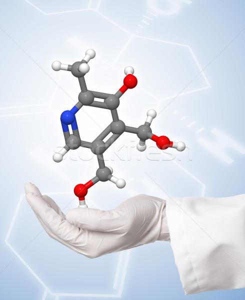 Scientist holding molecule model with chemical formula backgroun Stock photo © ShawnHempel