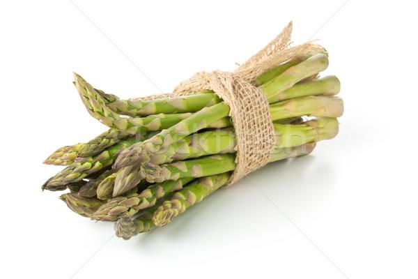 Tied bundle of fresh cut raw, uncooked green asparagus vegetable Stock photo © ShawnHempel