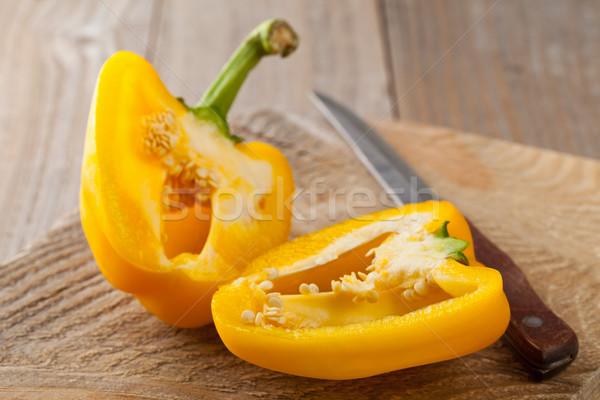 Preparing a yellow bell pepper on kitchen table Stock photo © ShawnHempel