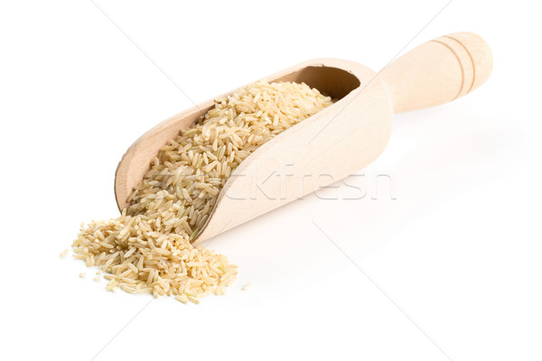 Natural brown uncooked rice in wooden scoop Stock photo © ShawnHempel