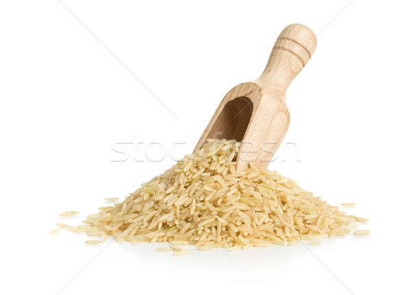Stock photo: Natural brown uncooked rice in wooden scoop