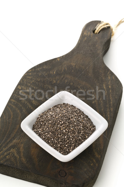 Raw unprocessed black chia seeds in small white bowl on wooden b Stock photo © ShawnHempel