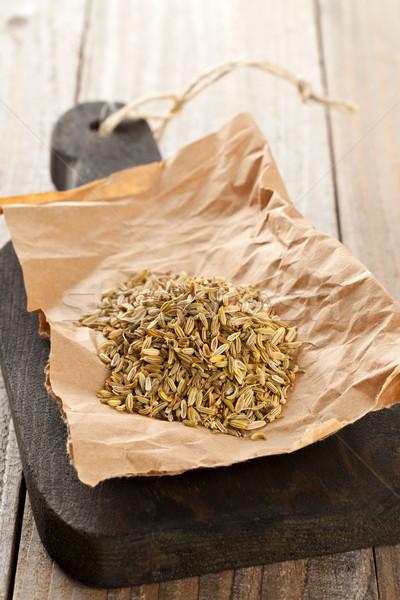 Heap of fennel seeds on kitchen board Stock photo © ShawnHempel