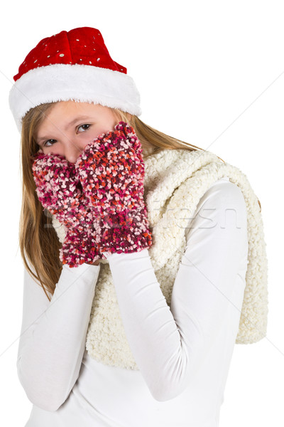 Young girl with white shirt, red winter cap and wooly gloves Stock photo © ShawnHempel