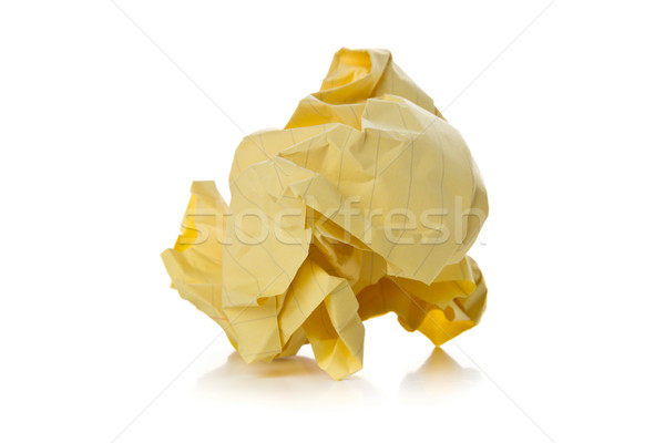 Crumbled yellow paper with linings ball on white background  Stock photo © ShawnHempel