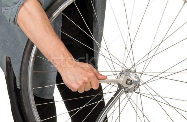 Man repairing front wheel on a bicycle Stock photo © ShawnHempel