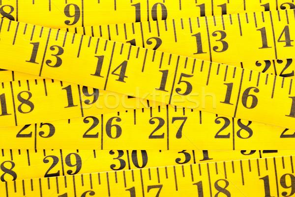 Frame filling yellow measurement tape background Stock photo © ShawnHempel