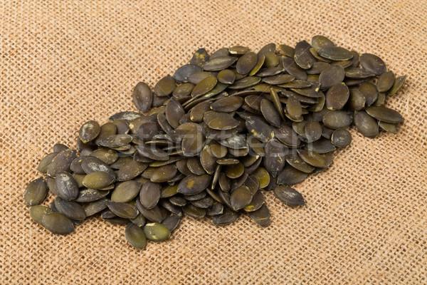 Citrouille semences toile de jute tas alimentaire santé Photo stock © ShawnHempel