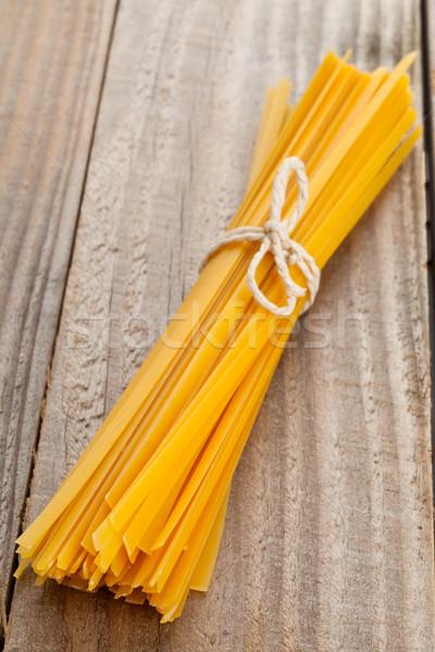 Tagliatelle pasta gedroogd houten tafel achtergrond keuken Stockfoto © ShawnHempel