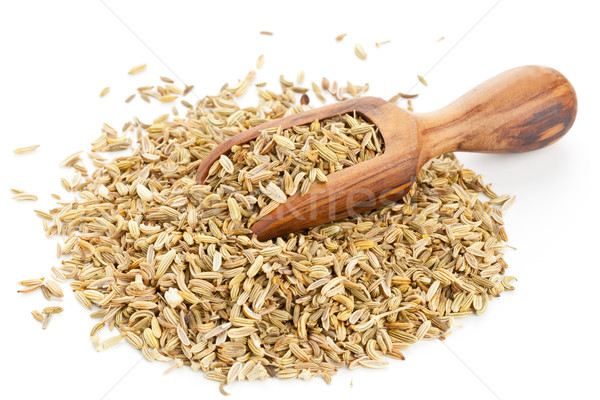 Stock photo: Fennel seed heap with wooden scoop