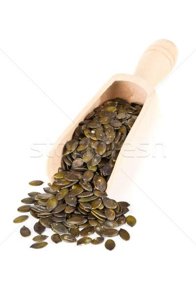 Unshelled pumpkin seeds in wooden scoop Stock photo © ShawnHempel