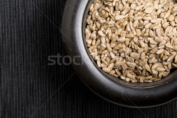 Shelled sunflower seeds in black mortar Stock photo © ShawnHempel