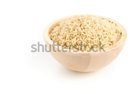 Natural brown uncooked rice in wooden bowl Stock photo © ShawnHempel
