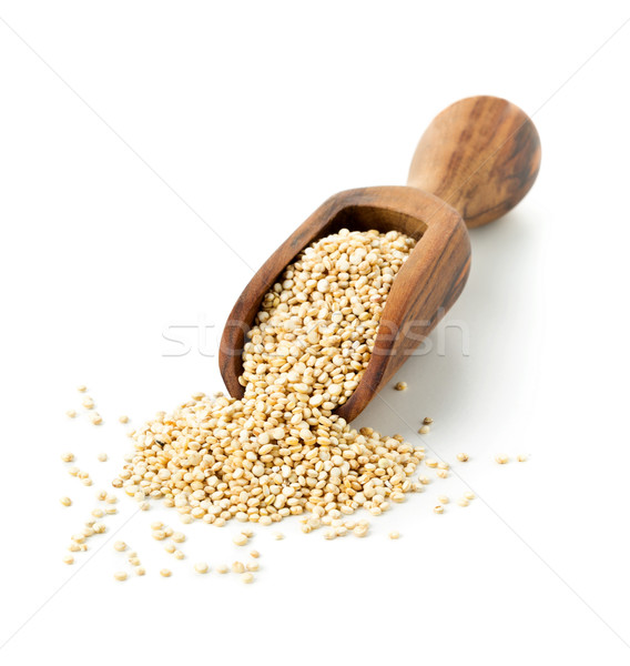 Raw, whole, unprocessed quinoa seed in wooden scoop on white Stock photo © ShawnHempel