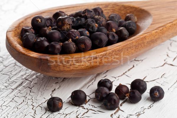 Dried juniper berries on spoon Stock photo © ShawnHempel