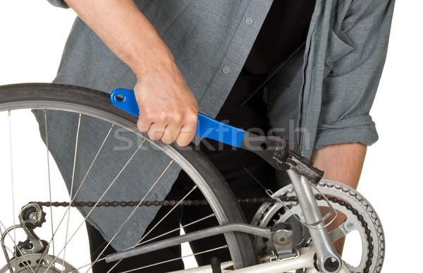 Man fixing pedals on a bicycle  Stock photo © ShawnHempel