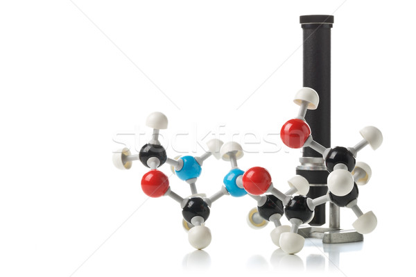 Chemical molecule model with old microscope over white backgroun Stock photo © ShawnHempel