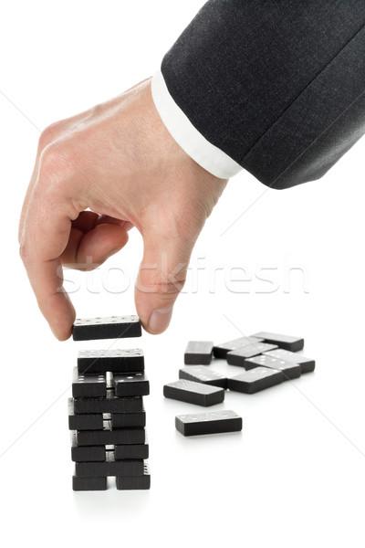 Milestone or progress concept - business man building domino tow Stock photo © ShawnHempel