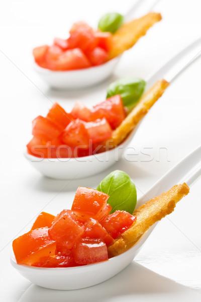 Tomate bruschetta delicioso servido aperitivo cucharas Foto stock © ShawnHempel