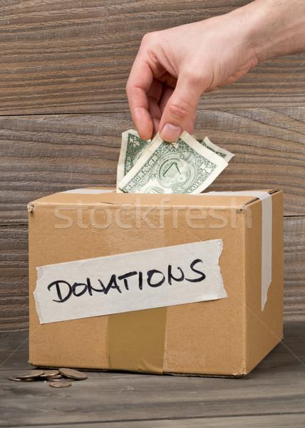 Man geld donaties dollar bankbiljet Stockfoto © ShawnHempel