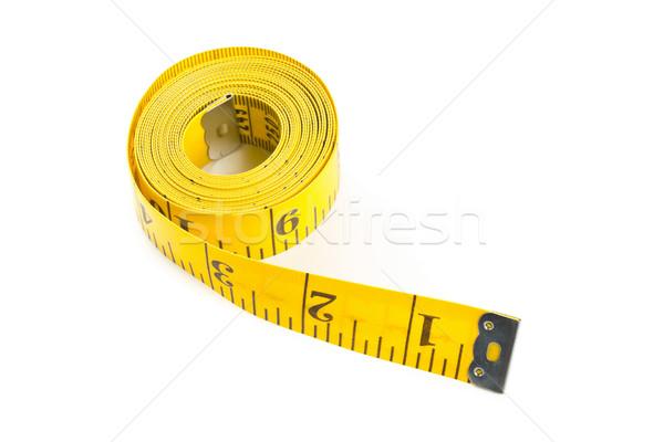 Yellow measure tape on white background Stock photo © ShawnHempel