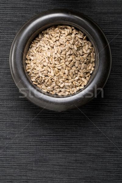 Shelled sunflower seeds in black mortar Stock photo © ShawnHempel