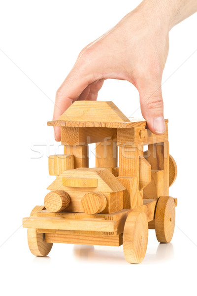 Man playing with wooden toy car  Stock photo © ShawnHempel