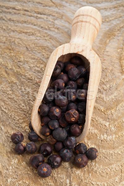 Juniper berries in wooden scoop Stock photo © ShawnHempel