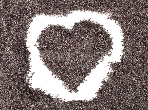 Heart shape formed by poppy seeds Stock photo © ShawnHempel