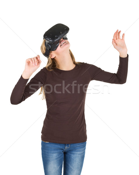 Blonde girl using VR - virtual reality headset Stock photo © ShawnHempel